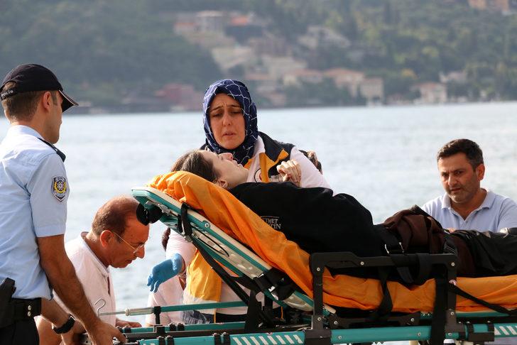 Denize düşen kadın oltayla kurtarıldı