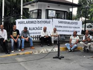 İşçiler belediyenin önünde oturma eylemi başlattı